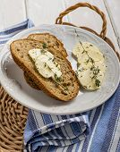 stock photo of fresh slice bread  - Slices of fresh bread with butter on the grass - JPG