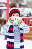 foto of cold drink  - Little boy drinking chocolate drink with marshmallows outdoors with snow background - JPG