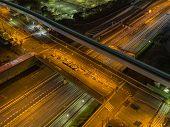 pic of crossroads  - Multilevel crossroads illuminated at night in Tokyo - JPG