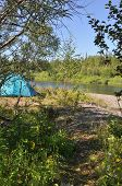 image of ural mountains  - Camping tent on the shore of a mountain river - JPG