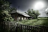picture of abandoned house  - Old mysterious abandoned house under dramatic lighting - JPG