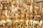 stock photo of yangon  - Wooden statues on a market stall in Yangon Myanmar - JPG