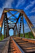 stock photo of trestle bridge  - The rust and corrosion is what gives this bridge character and beauty - JPG