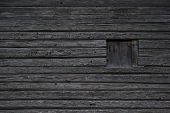 image of log cabin  - Dark wooden texture of log cabin with old window - JPG