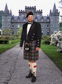 Scottish man in front of Inverary Castle poster