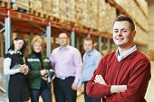 picture of dispatch  - male manager and workers in warehouse - JPG