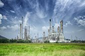 image of greenpeace  - Oil refinery along daytime with blue sky - JPG