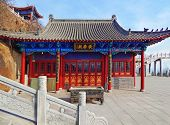 picture of cult  - Buddhist temple on a grief. In the city of Dalian. China. ** Note: Visible grain at 100%, best at smaller sizes - JPG