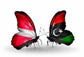picture of libya  - Two butterflies with flags on wings as symbol of relations Latvia and Libya - JPG
