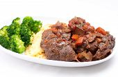 picture of veal  - home made osso buco veal shank braised with fresh tomato and aromatics - JPG