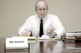 picture of irs  - IRS tax auditor man with a stern or mean expression - JPG