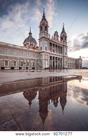 View Of The Almudena Cathedral In Madrid, Spain. Reflection On A Puddle.