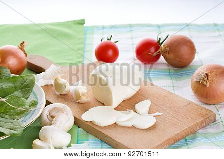 Few Slices And Rest Of Slovak Cheese On Cutting Board