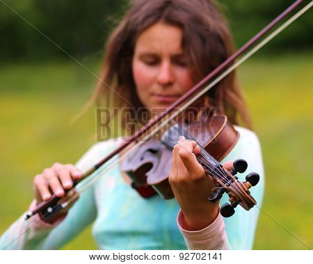 violinist on a meadow full of flowers, Young girl playing music instrument vintage picture