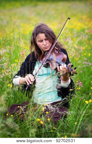 Violinist On A Meadow Full Of Flowers