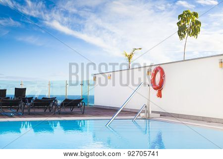Lounge sunbeds near swimming pool, vintage colours