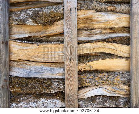 Firewood in an open wooden rack
