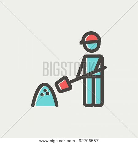 Man with shovel and sand icon thin line for web and mobile, modern minimalistic flat design. Vector icon with dark grey outline and offset colour on light grey background.