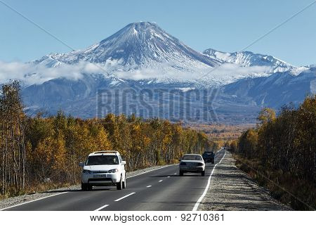 Cars On The Road To Avacha Volcano On Kamchatka. Russia, Far East