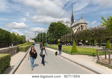 Tourists Walking Around The Notre Dame Cathedral In Paris, France