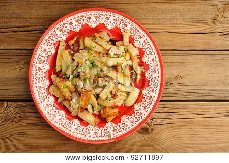 Fried Potatoes With Scallion In Red Plate Topview Copyspace