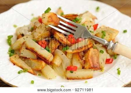 Fried Potatoes With Scallion And Chili In White Plate With Fork