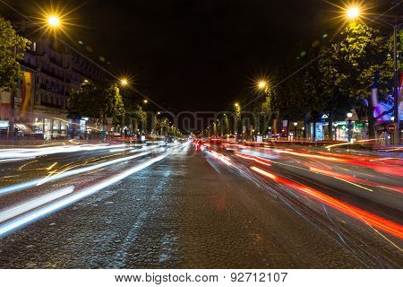 Evening Streetview With Illumination And Traffic Of Paris Champs Elysees