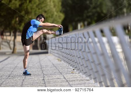 Athlete Man Stretching Legs Warming Up Calf Muscles Before Running Workout Leaning On Railing City U