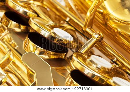 Shiny golden keys of alto saxophone close-up view