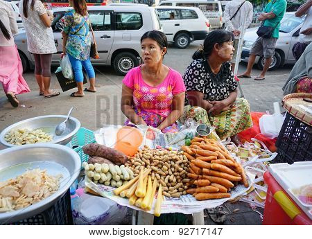 Burmese Women Selling Sweet Cakes In The Market