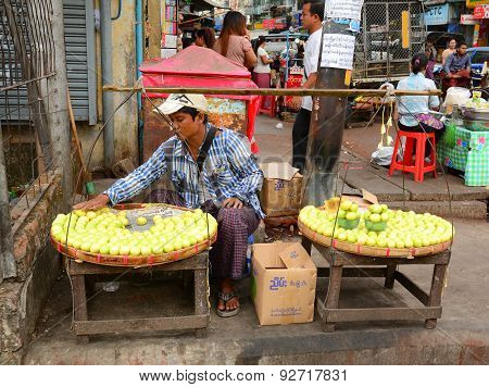 Burmese Women Selling Fresh Fruits At Bogyoke Market