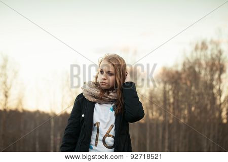 Portrait Of Caucasian Teenage Girl In A Spring Forest