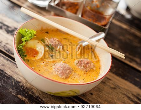Pork Noodle Tom Yum On Wood Table