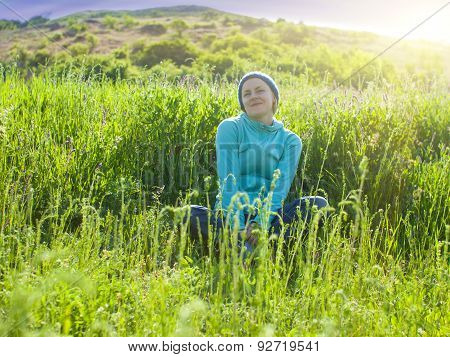 Portrait Of A Young Girl In A Grassy Field At Sunset.