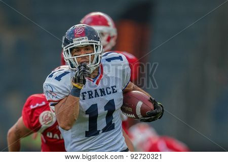 GRAZ, AUSTRIA - JUNE 2, 2014: WR Guillaume Rioux (#11 France) runs with the ball.