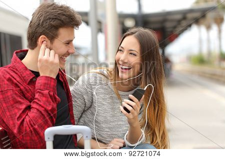 Happy Couple Of Travelers Sharing Music On Holidays