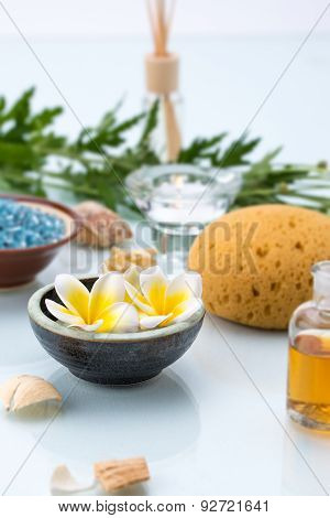 Spa Concept With Floating Flowers, Sponge, Essential Oil