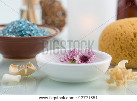Spa Concept With Floating Flowers Bath Salt And Bath Sponge