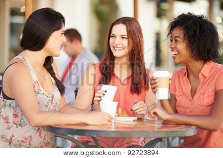 Three Female Friends Meeting In Caf\x81_