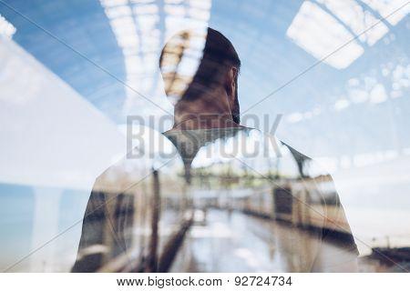 Double exposure of man