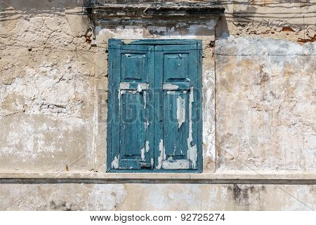 Old Window In Blue Color On Dirty Wall
