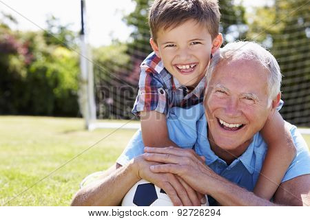 Portrait Of Grandfather And Grandson With Football