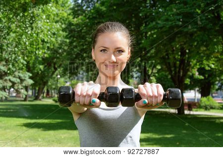 Sports Girl Doing Exercise With Easy Dumbbells