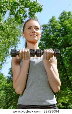Sports Girl Doing Exercise With Lightweight Dumbbells