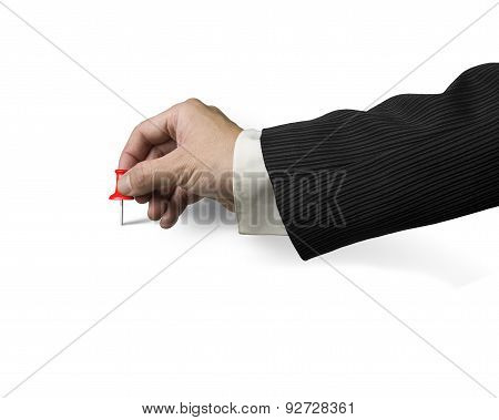 Male Hand Holding Red Pushpin Tacked On White