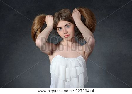 Calm, Poise, Serenity Concept. Woman Holds Her Hair
