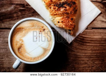 Coffee And Fresh Croissant For Breakfast On Rustic Wooden Table, Top View. Chocolate Croissant With