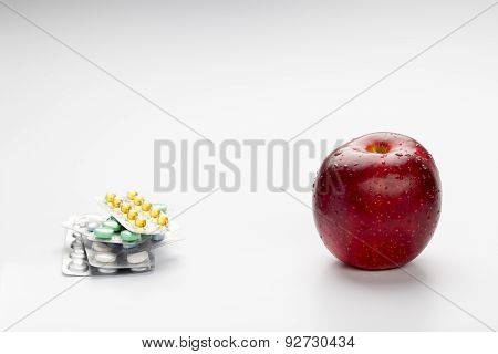 Red apple and pills blister