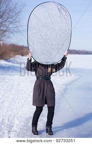 Photographer assistant holding reflector