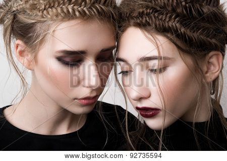 Closeup Portrait Of Two Beauty Models With Braids